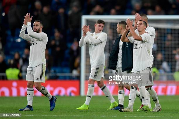 Real Madrid's players celebrate at the end of the Spanish league football match between Real Madrid and Valencia at the Santiago Bernabeu stadium in...