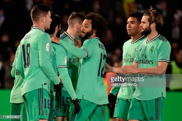 Real Madrid's players celebrate Spanish midfielder Brahim Diaz's goal during the Copa del Rey football match between Unionistas de Salamanca CF and...