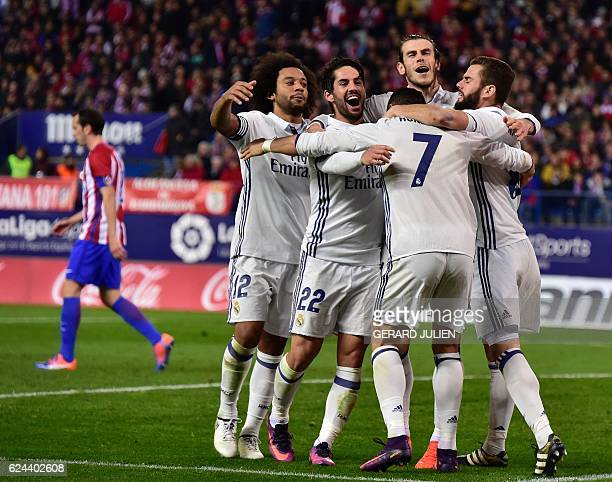 Real Madrid's players celebrate their third goal during the Spanish league football match between Club Atletico de Madrid and Real Madrid CF at the...