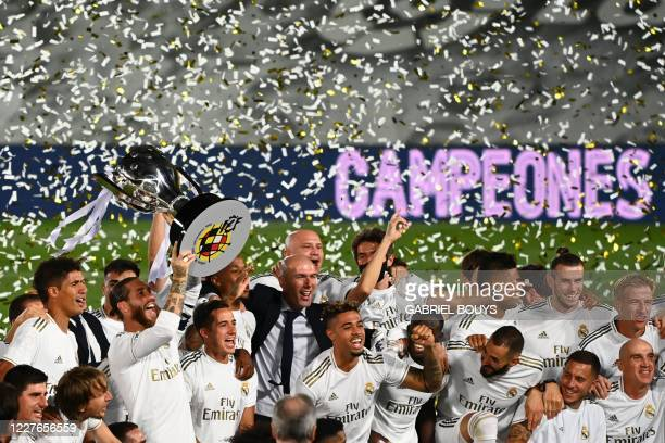 Real Madrid's players celebrate winning the Liga title after the Spanish League football match between Real Madrid CF and Villarreal CF at the...