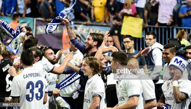 Real Madrid's players celebrate winning the Liga title after the Spanish league football match Malaga CF vs Real Madrid CF at La Rosaleda stadium in...