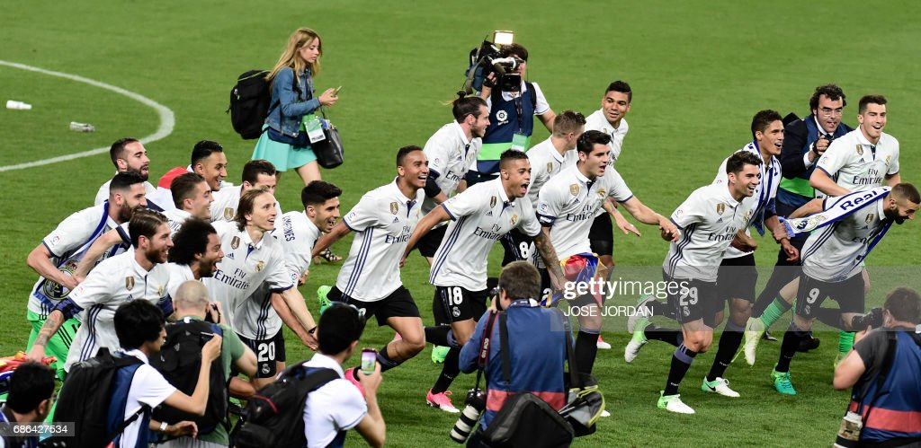 Real Madrid's players celebrate winning the Liga title after the Spanish league football match Malaga CF vs Real Madrid CF at La Rosaleda stadium in Malaga on May 21, 2017. /