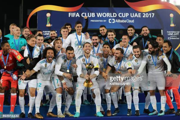 Real Madrid's players celebrate with the FIFA Club World Cup trophy following their victory in the final football match against Gremio FBPA at the...