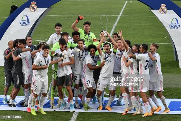 Real Madrid's players celebrates with the trophy their victory at the end of the football UEFA Youth League 2019/2020 final between Benfica and Real...