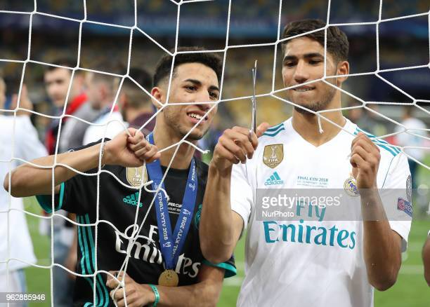 Real Madrid's players cut the goal net after winning the UEFA Champions League final football match between Liverpool and Real Madrid at the Olympic...