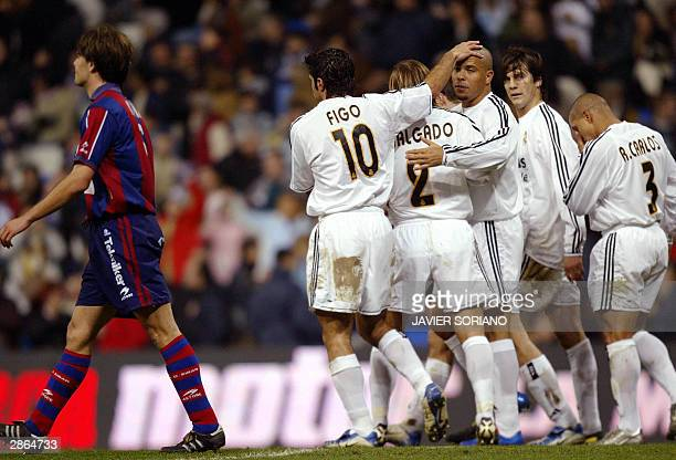 Real Madrid's players Luis Figo, Michel Salgado, Ronaldo, Santiago Solari and Roberto Carlos, celebrate after scoring their first goal during their...