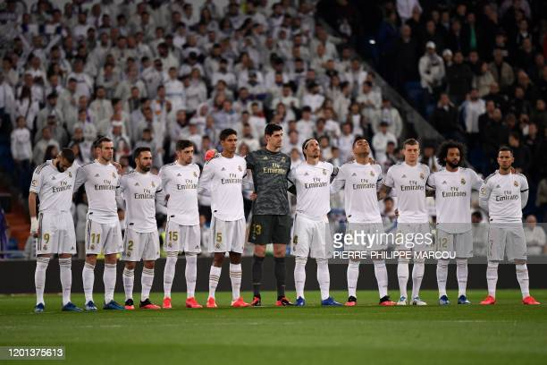 Real Madrid's players observe a minute of silence in memory of late Spanish journalist and novelist David Gistau before the Spanish league football...