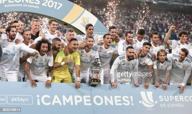 Real Madrid's players pose as they celebrate their Supercup after winning the second leg of the Spanish Supercup football match Real Madrid vs FC...