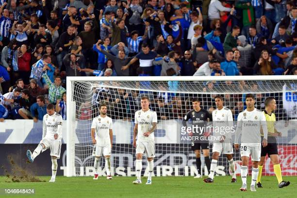 Real Madrid's players react to Alaves' goal during the Spanish league football match between Deportivo Alaves and Real Madrid CF at the Mendizorroza...