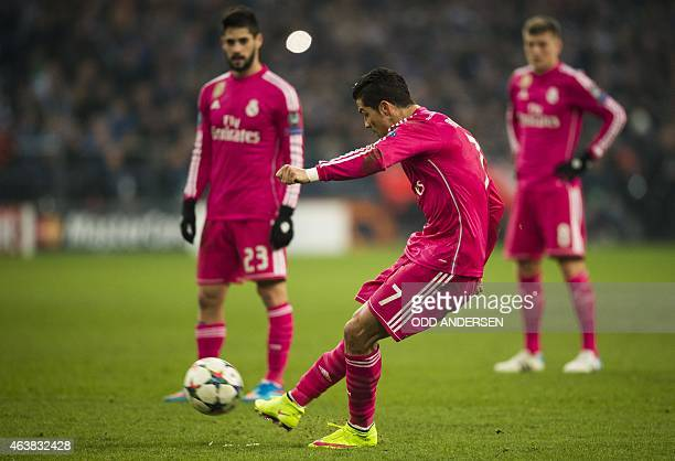 Real Madrid's Portugese forward Cristiano Ronaldo shoots a freekick during the firstleg round of 16 UEFA Champions league football match between...