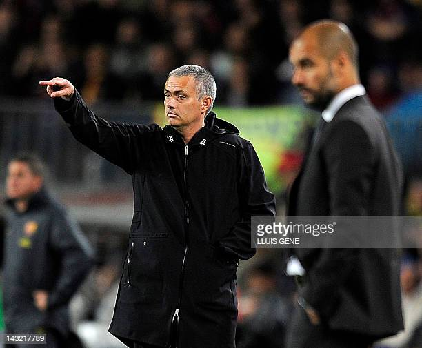 Real Madrid's Portuguese coach Jose Mourinho and Barcelona's coach Josep Guardiola gesture during the Spanish League 'El clasico' football match...