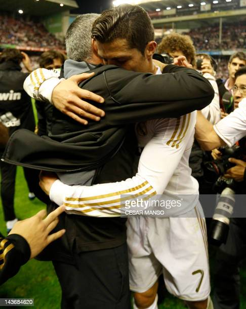 Real Madrid's Portuguese coach Jose Mourinho and Real Madrid's Portuguese forward Cristiano Ronaldo celebrate after winning the Spanish league...