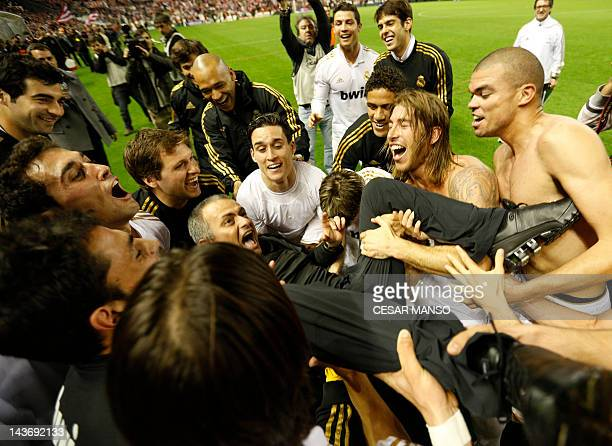 Real Madrid's Portuguese coach Jose Mourinho celebrates with his players after winning the Spanish leage football match Athletic Bilbao against Real...