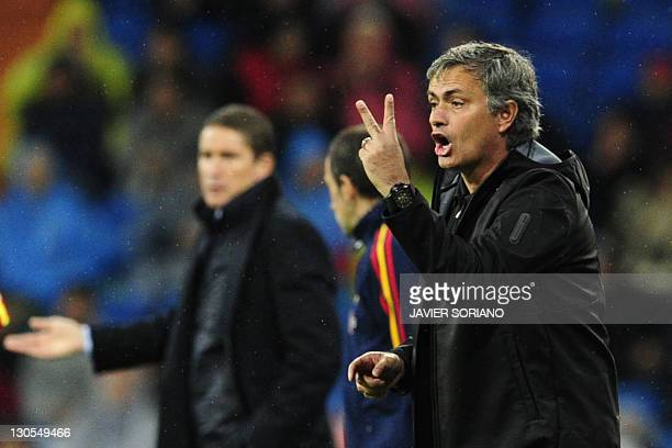 Real Madrid's Portuguese coach Jose Mourinho gestures during the Spanish League football match Real Madrid against Villarreal at the Santiago...