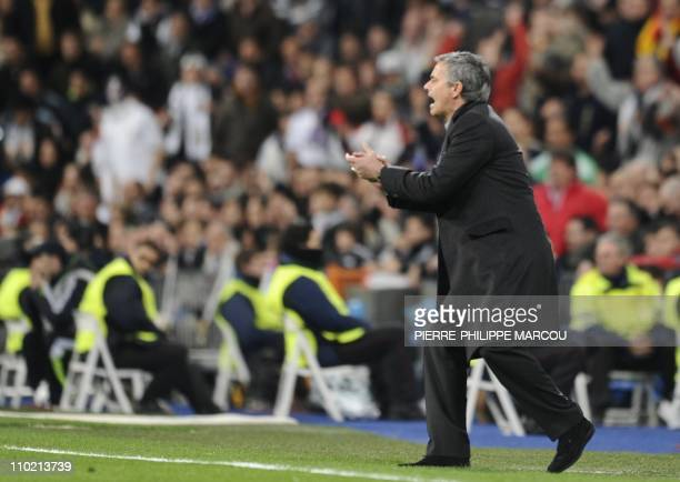 Real Madrid's Portuguese coach Jose Mourinho gestures during their Champions League football match Real Madrid vs Olympique Lyonnais on March 16 2011...