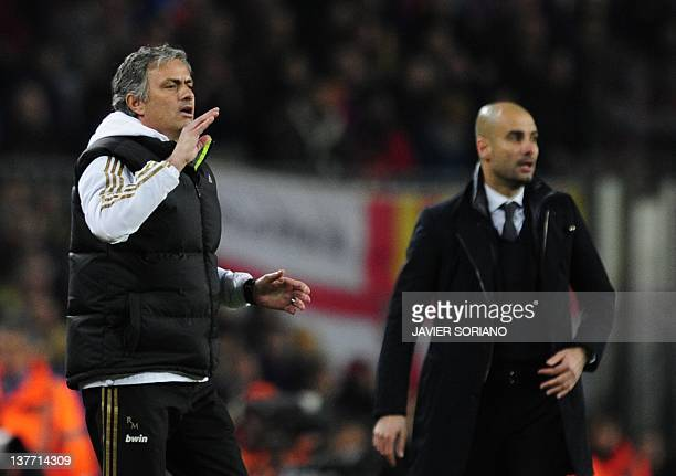 Real Madrid's Portuguese coach Jose Mourinho gestures in front of Barcelona's coach Josep Guardiola after Real Madrid's defender Sergio Ramos...