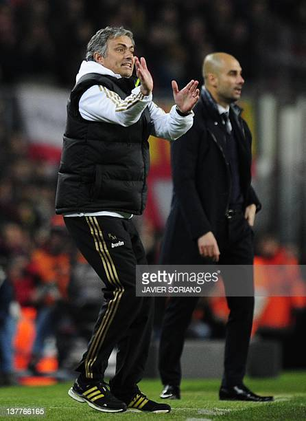 Real Madrid's Portuguese coach Jose Mourinho gestures in front of Barcelona's coach Josep Guardiola after he received a red card during the second...