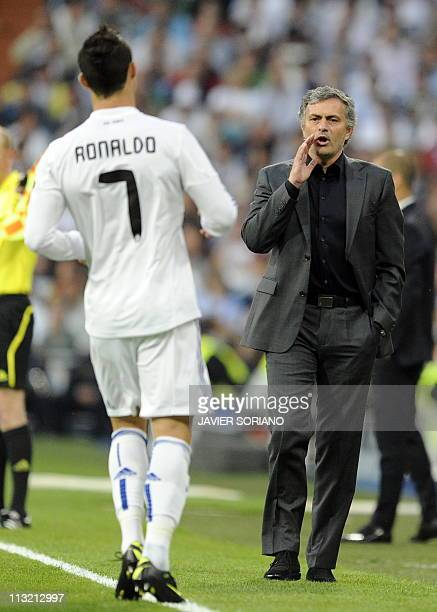 Real Madrid's Portuguese coach Jose Mourinho gives instructions to Real Madrid's Portuguese forward Cristiano Ronaldo during the Champions League...