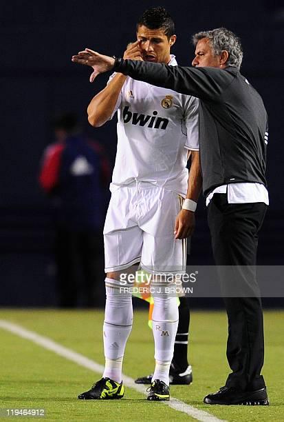 Real Madrid's Portuguese coach Jose Mourinho gives instructions to forward Cristiano Ronaldo during action against CD Guadalajara at Qualcomm Stadium...