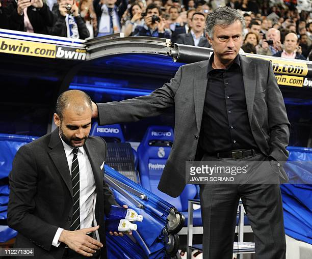 Real Madrid's Portuguese coach Jose Mourinho greets Barcelona's coach Josep Guardiola before 'El clasico' Spanish League football match Real Madrid...