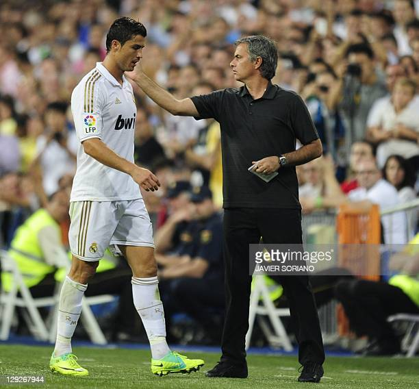 Real Madrid's Portuguese coach Jose Mourinho greets Real Madrid's Portuguese forward Cristiano Ronaldo during the Spanish League football match Real...