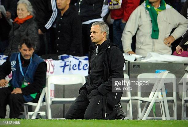 Real Madrid's Portuguese coach Jose Mourinho reacts during the penalty kicks of the UEFA Champions League second leg semifinal football match Real...
