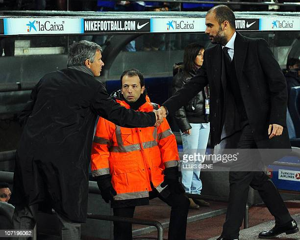 Real Madrid's Portuguese coach Jose Mourinho shakes hands with Barcelona's coach Josep Guardiola prior to the Spanish league 'clasico' football match...