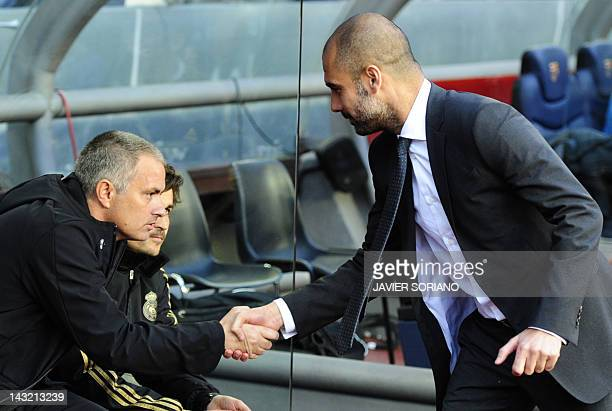 Real Madrid's Portuguese coach Jose Mourinho shakes hands with Barcelona's coach Josep Guardiola during the Spanish League 'El clasico' football...