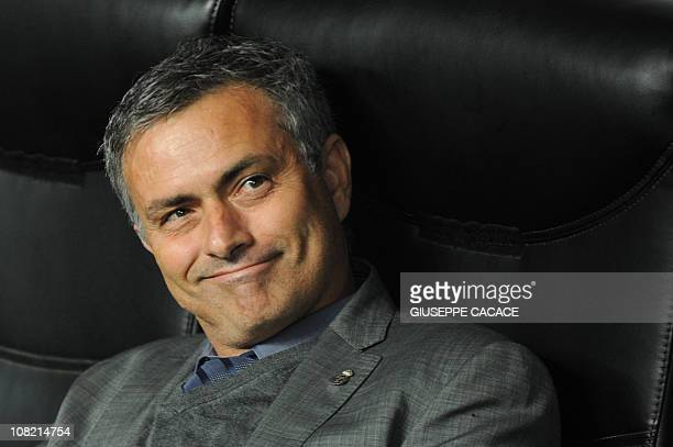 Real Madrid's Portuguese coach Jose Mourinho smiles before his team's Champions League group G football match against AC Milan on November 3 2010 at...