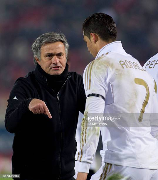 Real Madrid's Portuguese coach Jose Mourinho speaks with Real Madrid's Portuguese forward Cristiano Ronaldo during the Spanish league football match...