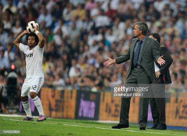 Real Madrid's Portuguese coach Jose Mourinho talks to Real Madrid's Brazilian defender Marcelo during the Spanish league football match Real Madrid...