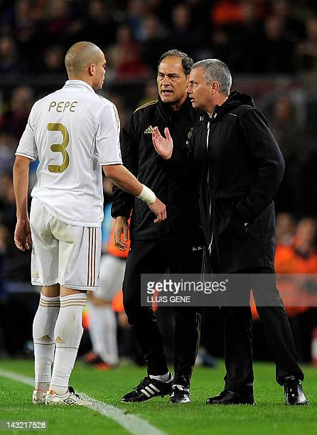 Real Madrid's Portuguese coach Jose Mourinho talks to Real Madrid's Portuguese defender Pepe during the Spanish League El clasico football match...
