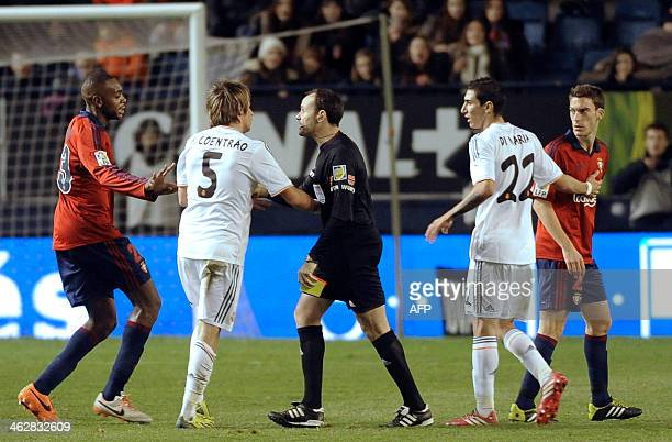 Real Madrid's Portuguese defender Fabio Coentrao is sent off by referee Antonio Miguel during the Spanish Copa del Rey round of 16 secondleg football...
