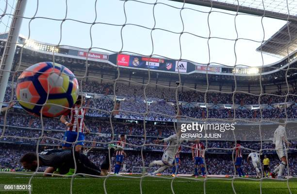 Real Madrid's Portuguese defender Pepe celebrates a goal during the Spanish league football match Real Madrid CF vs Club Atletico de Madrid at the...
