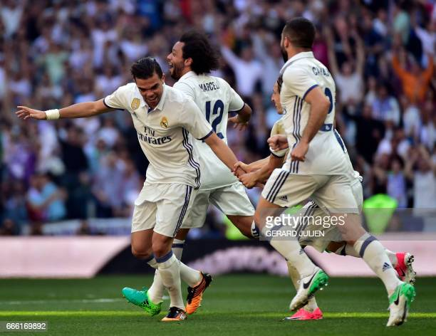 Real Madrid's Portuguese defender Pepe celebrates a goal with teammates during the Spanish league football match Real Madrid CF vs Club Atletico de...