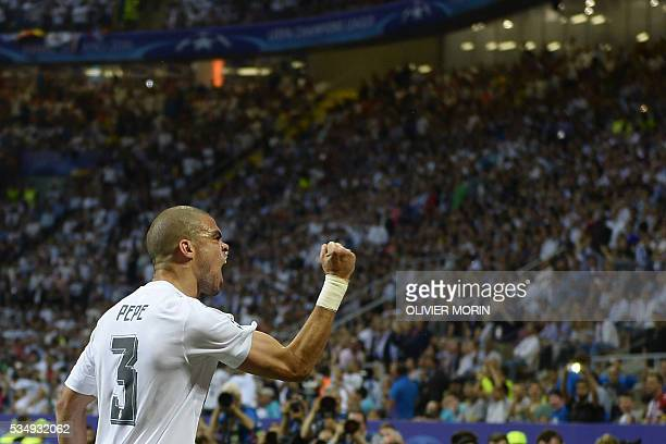 TOPSHOT Real Madrid's Portuguese defender Pepe celebrates after Real Madrid scored the opening goal during the UEFA Champions League final football...