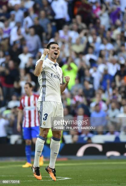 Real Madrid's Portuguese defender Pepe celebrates scoring a goal during the Spanish league football match Real Madrid CF vs Club Atletico de Madrid...