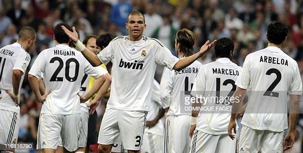 Real Madrid's Portuguese defender Pepe contest a yellow card during a Liga football match against Getafe at Santiago Bernabeu stadium in Madrid on...
