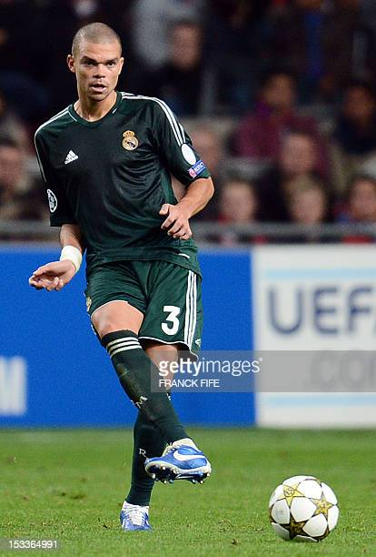 Real Madrid's Portuguese defender Pepe passes the ball during the UEFA Champions League Group D football match Ajax Amsterdam vs Real Madrid on...