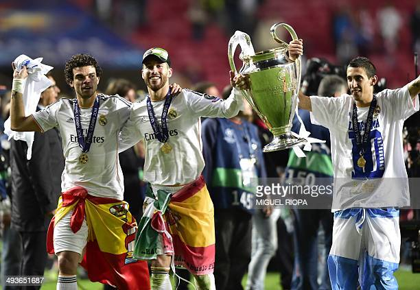 Real Madrid's Portuguese defender Pepe Real Madrid's defender Sergio Ramos and Real Madrid's Argentinian midfielder Angel di Maria celebrate with the...
