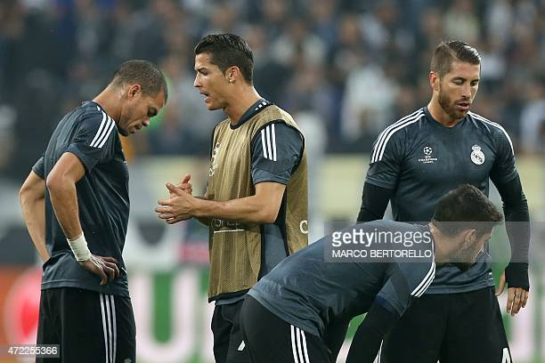 Real Madrid's Portuguese defender Pepe Real Madrid's Portuguese forward Cristiano Ronaldo and Real Madrid's defender Sergio Ramos warm up before the...