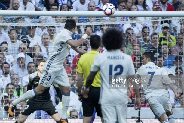 Real Madrid's Portuguese defender Pepe scores a goal during the Spanish league football match Real Madrid CF vs Club Atletico de Madrid at the...