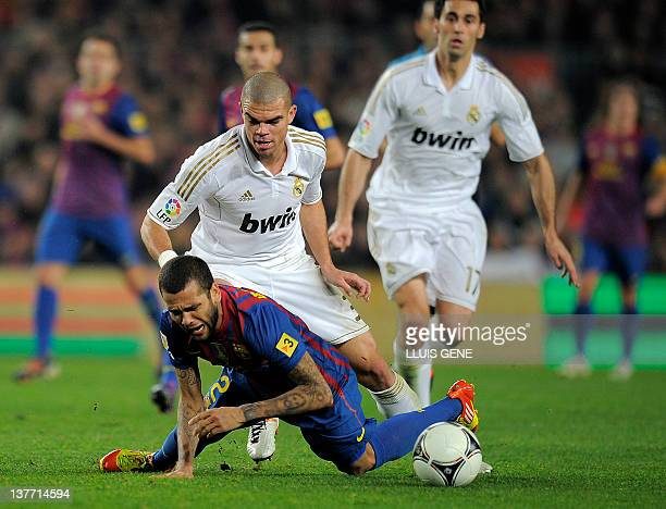 Real Madrid's Portuguese defender Pepe vies with Barcelona's Brazilian defender Daniel Alves during the second leg of the Spanish Cup quarterfinal El...