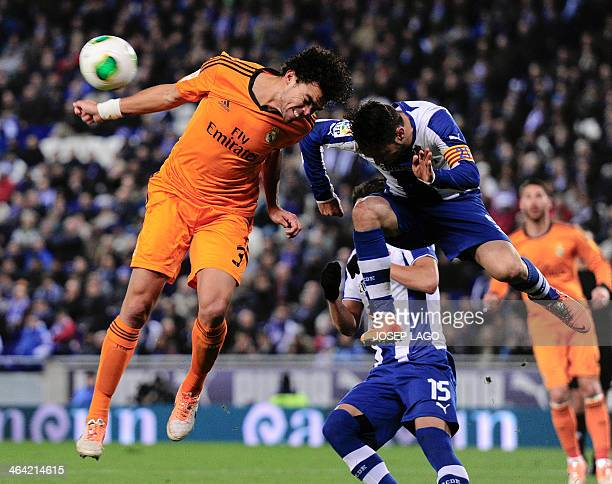 Real Madrid's Portuguese defender Pepe vies with Espanyol's forward Sergio Garcia during the Spanish Copa del Rey quarter-final first-leg football...