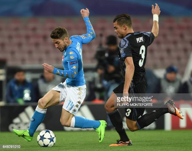 Real Madrid's Portuguese defender Pepe vies with Napoli's forward from Belgium Dries Mertens during the UEFA Champions League football match SSC...