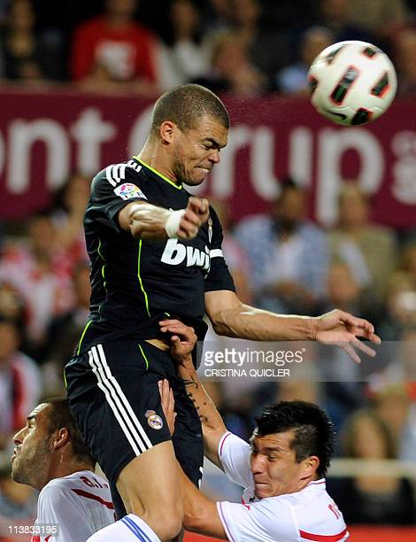 Real Madrid's Portuguese defender Pepe vies with Sevilla's Chilean midfielder Gary Medel during their Spanish league football match Sevilla FC vs...