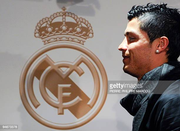 Real Madrid's Portuguese football player Cristiano Ronaldo poses at Santiago Bernabeu stadium in Madrid on December 16 2009 with his biography...