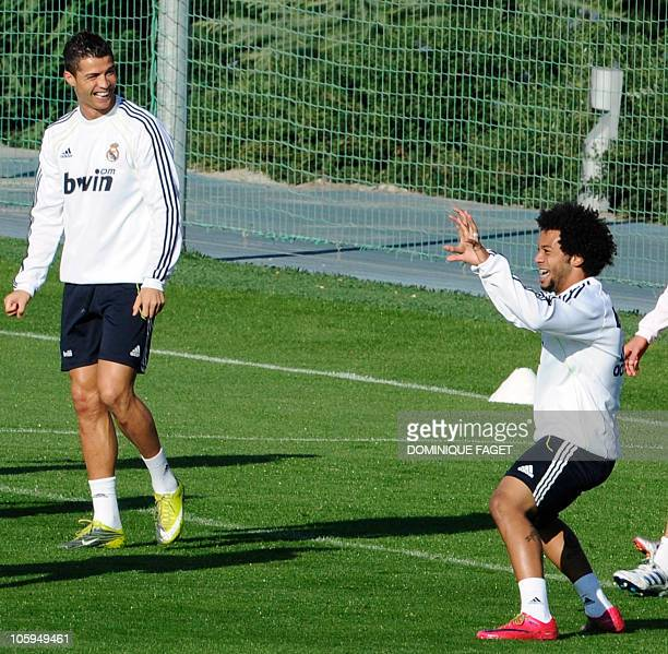 Real Madrid's Portuguese forward Cristiano Ronaldo and Brazilian defender Marcelo joke during a training session at Real Madrid's sport city on...
