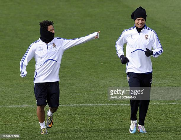 Real Madrid's Portuguese forward Cristiano Ronaldo and Brazilian defender Marcelo take part in a training session at Real Madrid's sport city on...