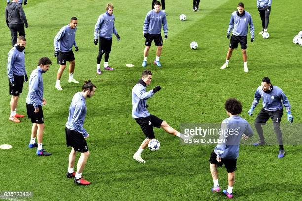Real Madrid's Portuguese forward Cristiano Ronaldo and his teammates take part in a training session at Valdebebas training ground in Madrid on...